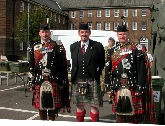 P/M Waterton-Anderson with the Pipe Major & Pipe Sergeant of the 1st Batt. Scots Guards.